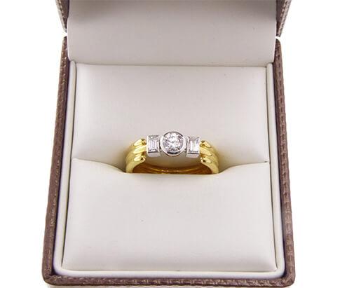 Gouden ring met diamant en briljant