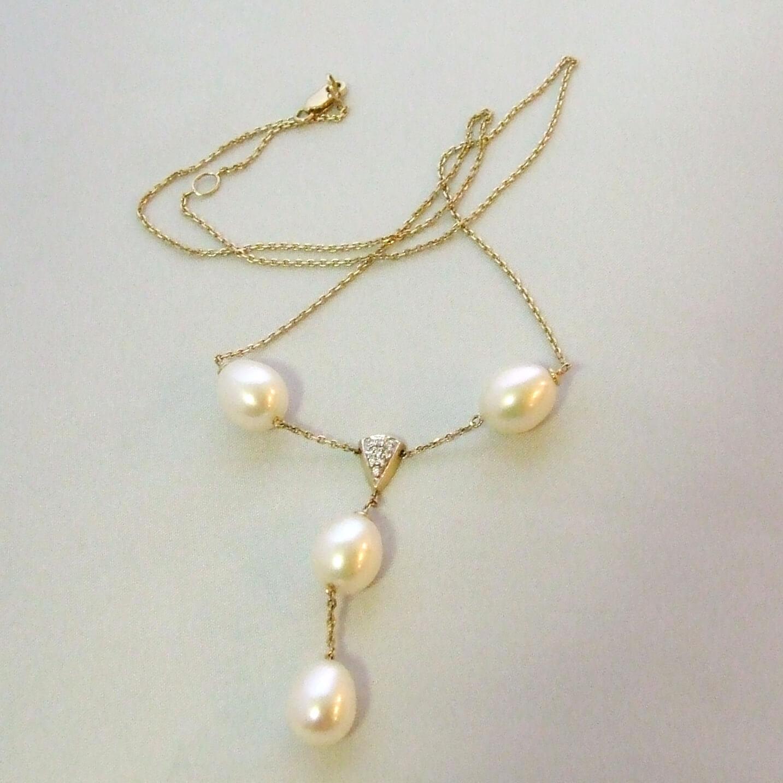 Gouden collier met parels en diamant