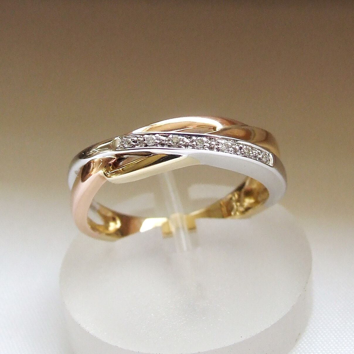 Gouden tricolor ring met diamanten