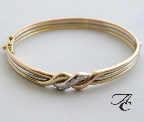 Gouden tricolor armband met diamant
