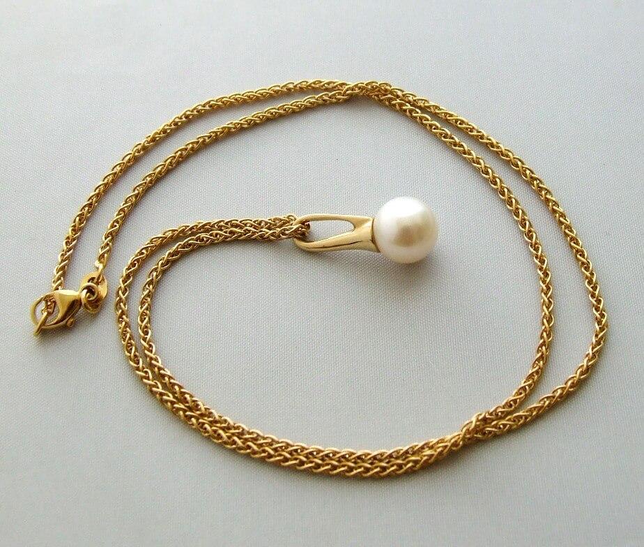 Geel gouden collier met parelhanger