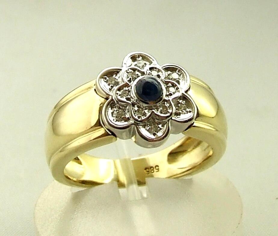 Gouden saffieren en diamanten ring