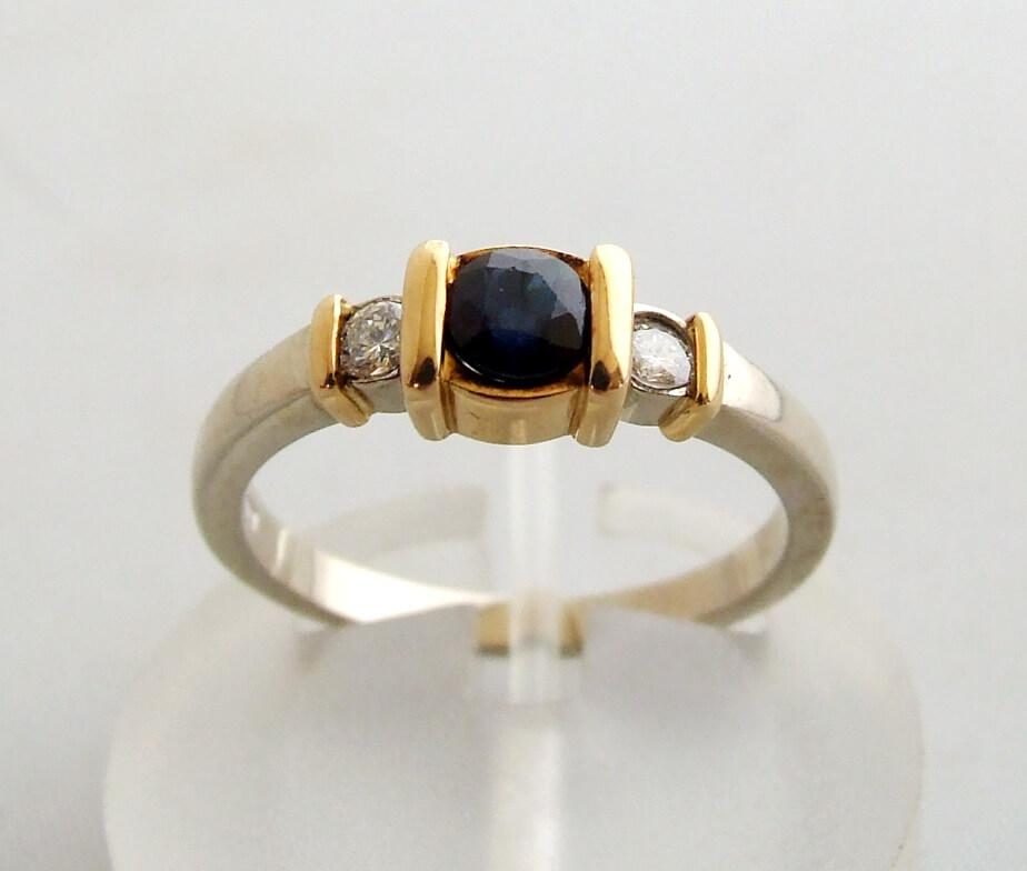 Bicolor gouden ring met diamant en saffier