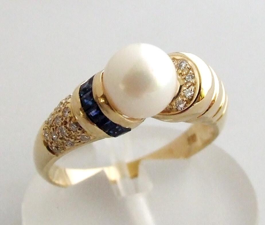 Gouden ring met saffier, diamant en parel