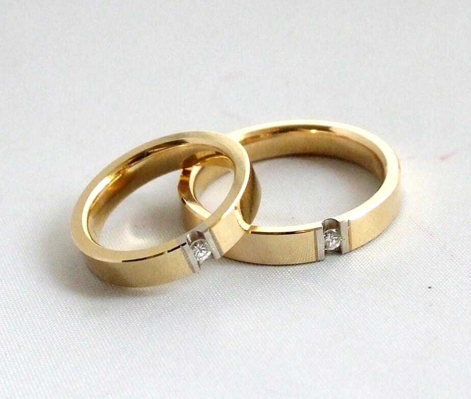 Gouden trouwringen met Christian diamanten