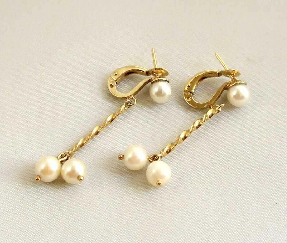 Gouden oorbellen met parels