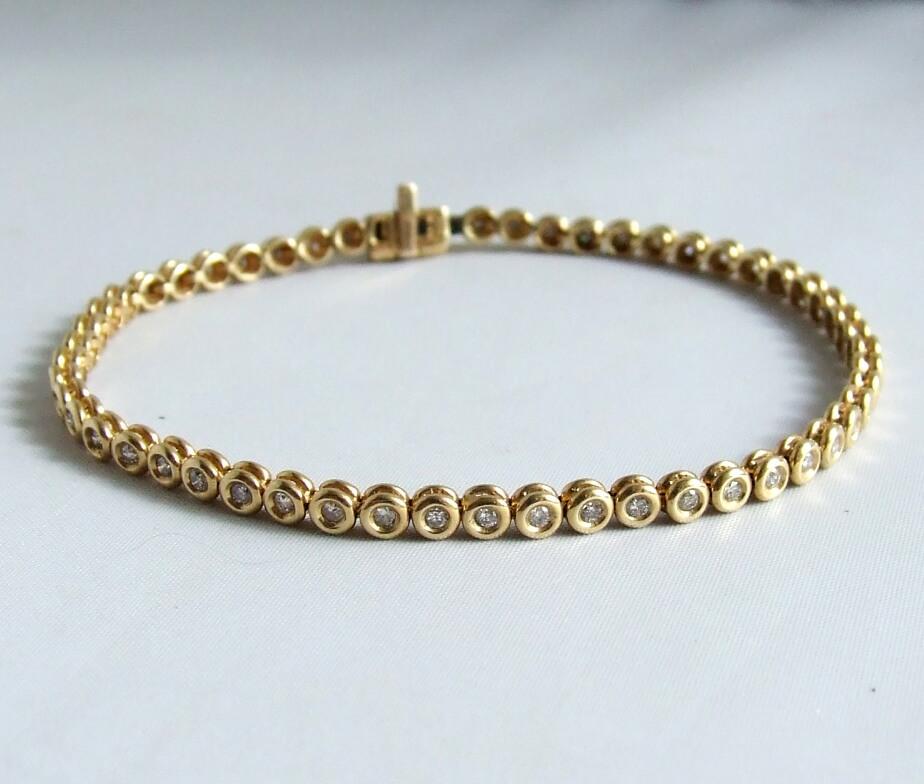 Gouden tennisarmband met diamanten