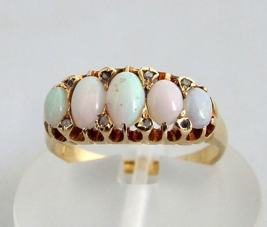 18 karaat gouden ring met opaal en roosdiamant