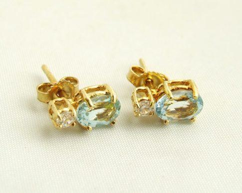 Gouden oorbellen met aquamarijn en zirkonia