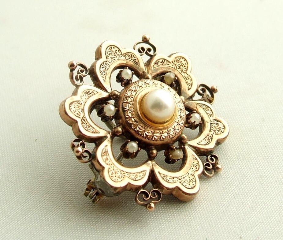 Goud en zilveren broche met parels