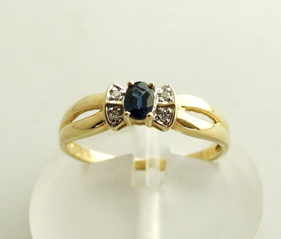 Gouden saffieren ring met diamanten