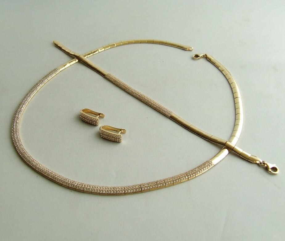 Geel gouden set collier, armband en oorbellen met zirkonia