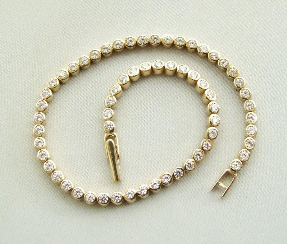 Gouden tennisarmband met zirkonia