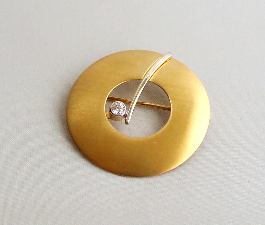 Gouden broche met zirkonia
