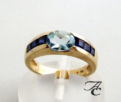 Gouden ring met saffier en topaas