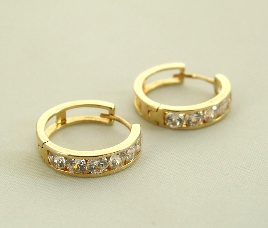 Geel gouden Christian oorbellen met zirkonia