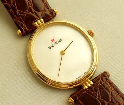 Gouden Rene Becaud horloge