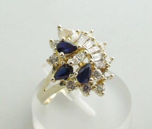 Gouden ring met zirkonia en synthetische saffier