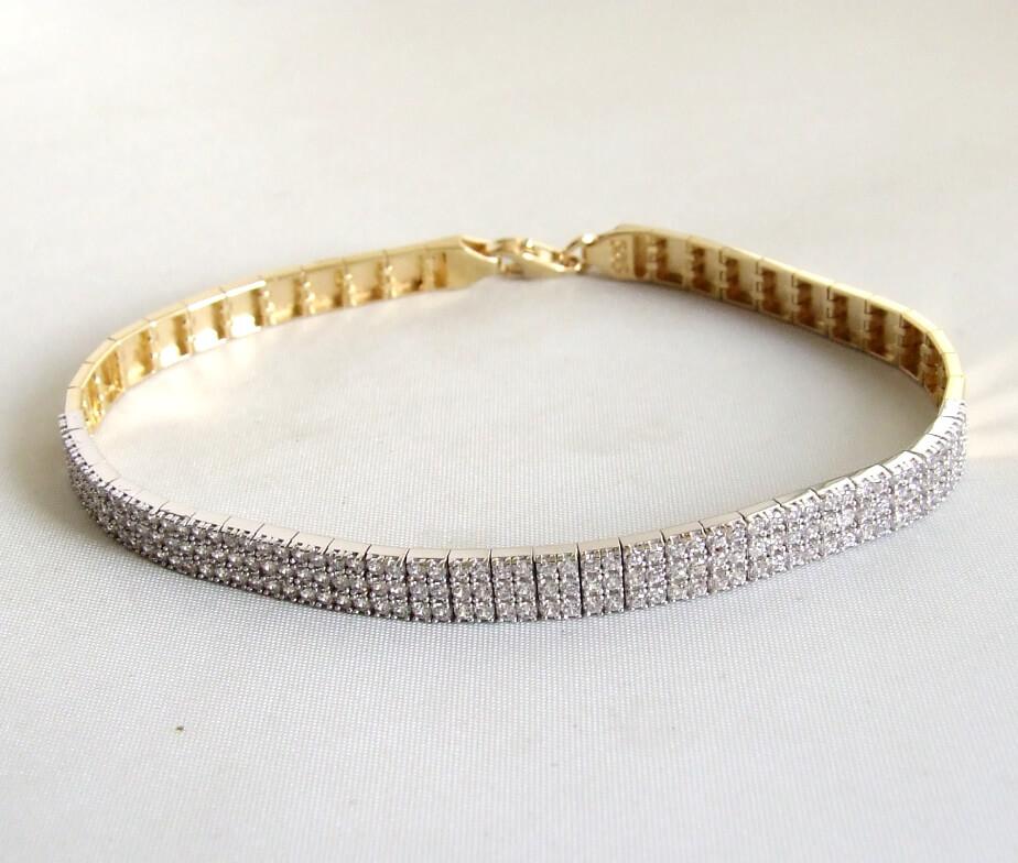 14 karaat geel- en wit gouden armband met zirkonia