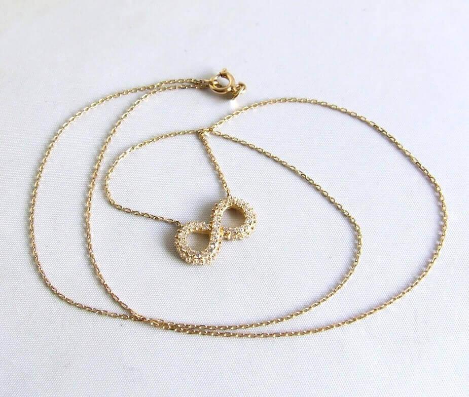 Gouden Infinity collier met zirkonia