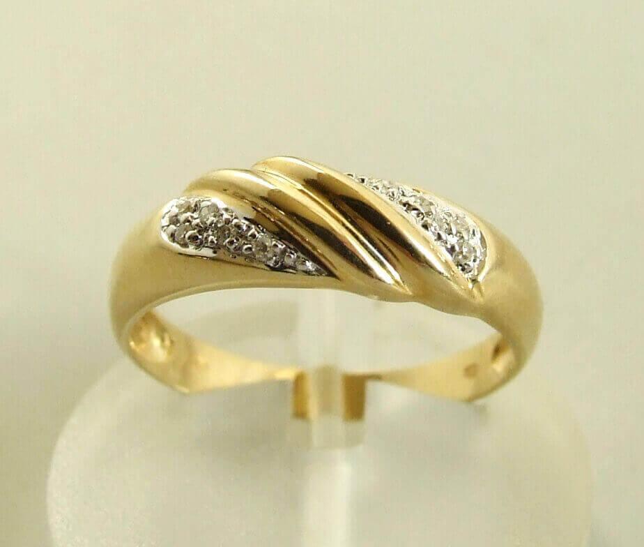 Occasion geel gouden ring met diamanten