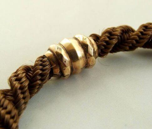 14 karaat rosé gouden armband met echt haar
