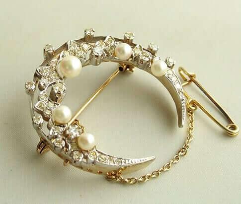 Bicolor broche met parels en diamanten