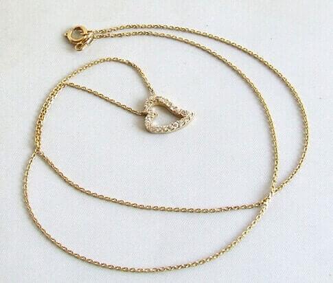 Gouden collier en hanger met zirkonia