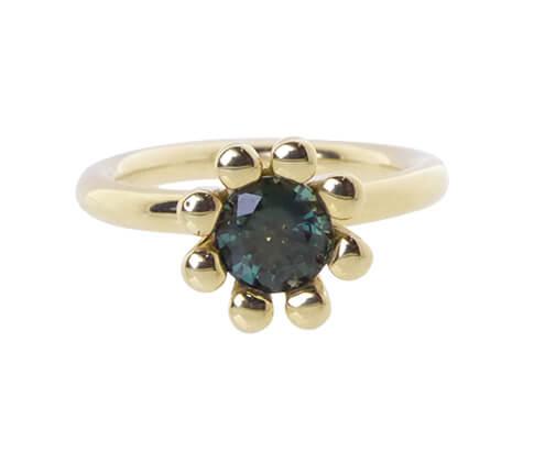 Gouden ring met groene saffier