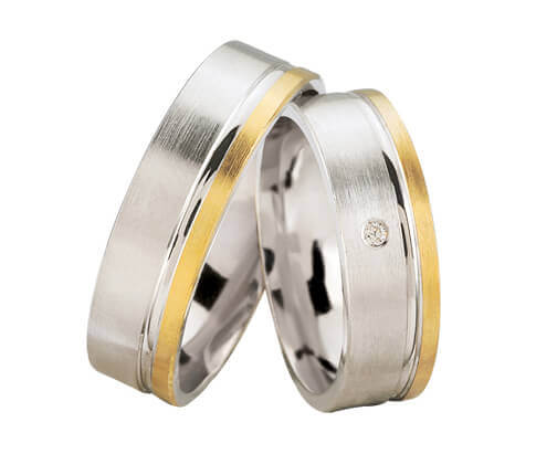Bicolor trouwringen met 1 diamant
