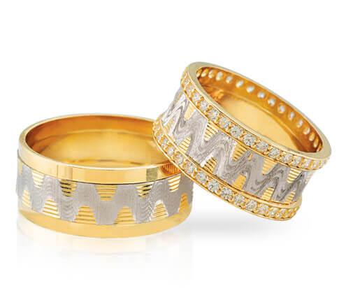 Diamanten trouwringen met golvende lijnen