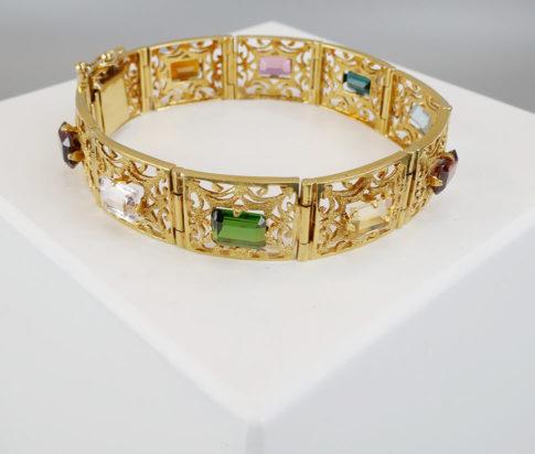 Gouden armband met edelstenen