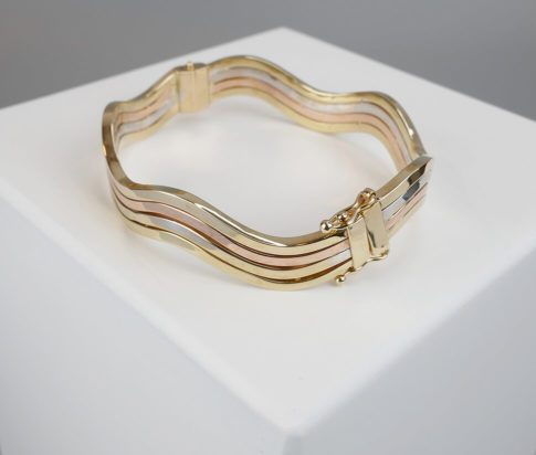 Gouden tricolor slavenarmband golvend model