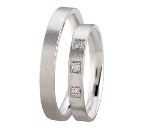 Wit gouden trouwringen met 3 diamanten