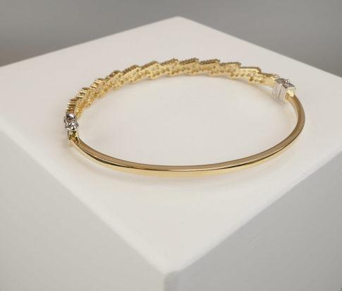 Geel gouden zirkonia schakelarmband
