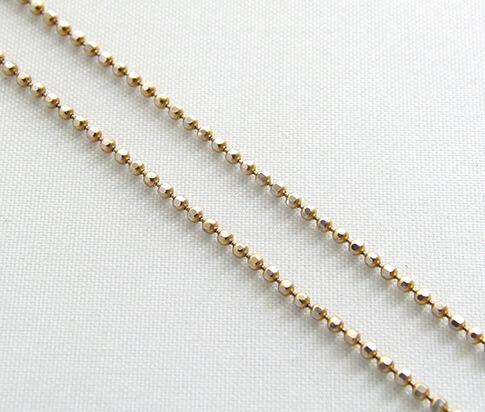 Gouden balletjes collier