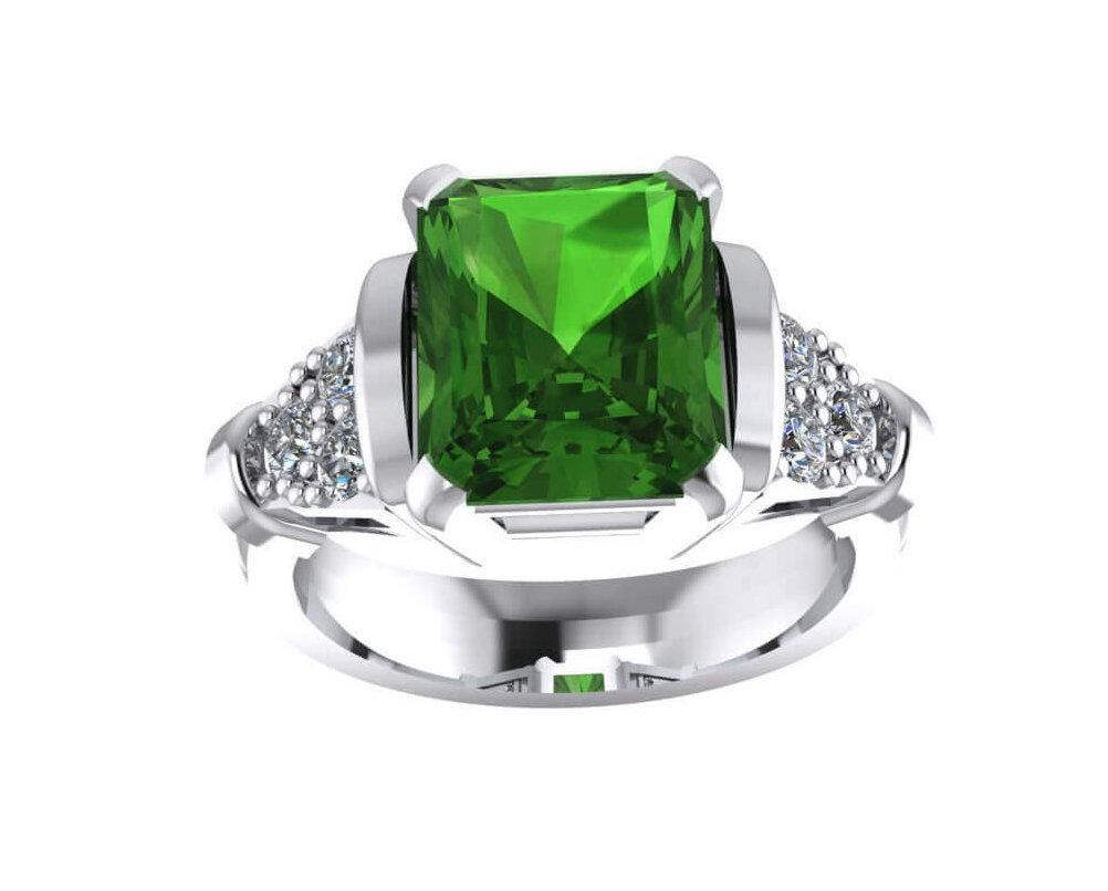 Wit gouden smaragd ring met diamanten