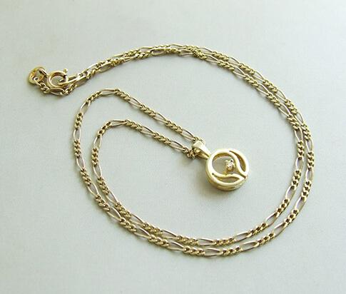 Occasion gouden collier en hanger met diamant