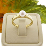Christian parel ring met diamanten