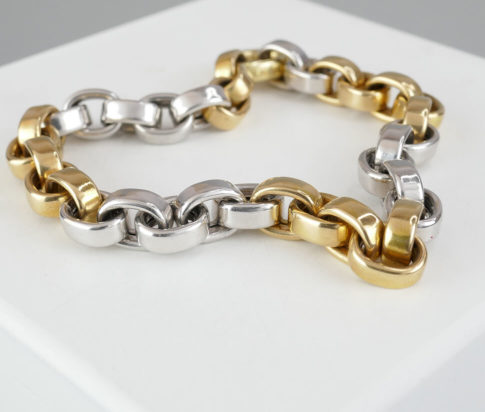 Bicolor gouden schakelarmband