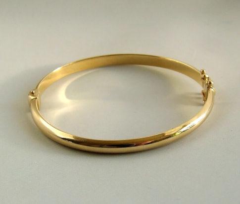 Christian 14 karaat gouden slavenarmband