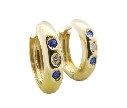 Gouden oorclips met saffier en zirkonia