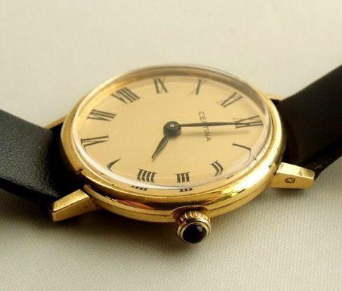 Gouden Certina horloge