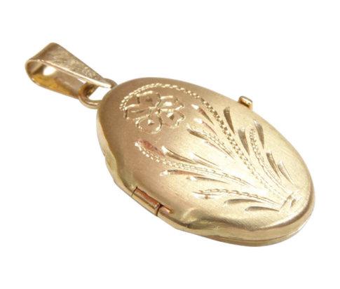 Gouden medaillon met bloem motief