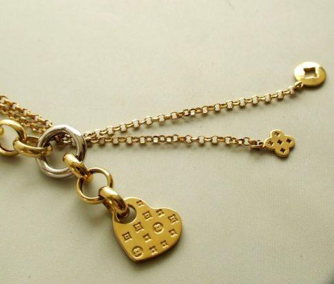 Gouden collier met hangers