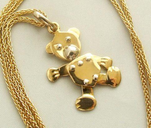 Gouden collier met teddybeer hanger