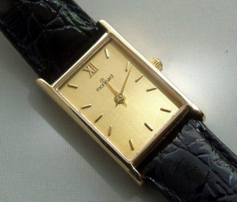 Gouden Monnard horloge met leren band