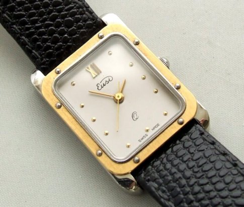 Goud op staal horloge met leren band