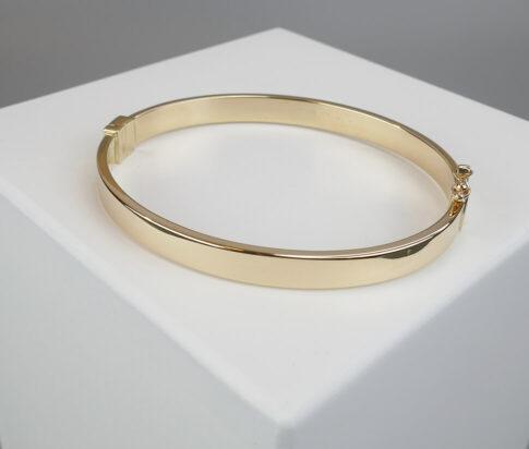 Geel gouden Christian 14 karaat slavenarmband