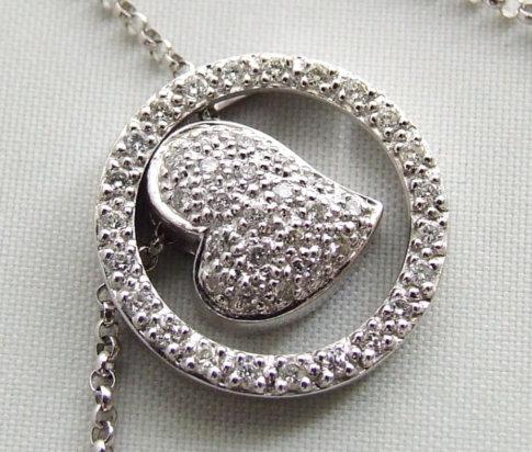 Gouden collier met diamanten harten hanger